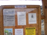 Official notices and one editorial at the Trail Lake Trailhead on the Shoshone National Forest