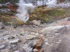 Steam and hot waters emanating from the Earth