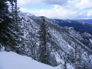 The snowy north flank of Sepulcher Mountain