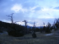 Sun setting, looking east towards the Washburn Range, from the Upper Mammoth Terraces