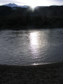 Sun setting behind Electric Peak, reflecting off the Yellowstone River in Montana at the McConnell Fishing Access
