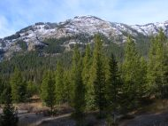 Looking up from Soda Butte Creek, snowy ridge in Yellowstone National Park