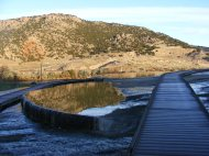 Hillside reflected of a pool at Hot Springs State Park, Wyoming, looking down on the Bighorn River