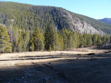 Shadows creeping across the meadow where the public can find both Gold Creek Campground and Trailhead, the former to the right along with barely seen Brown's Gulch