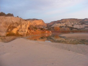 The sunrise striking the sandstone above the Yampa River at the point where it enters its canyon within Dinosaur National Monument