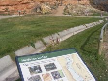 Medicine Lodge Archaeological Site signage, with the panels in the background