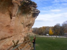 The sandstone outcropping at Medicine Lodge, an interesting timeline etched into the lawn seen beyond