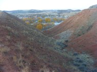Looking down a red gully towards Thermopolis