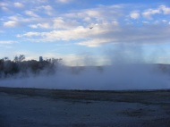 Steam rising above the tufa rimmed hot pools, Hot Springs State Park in Wyoming