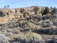 Weathered granite above the sagebrush steppe, a boundary
