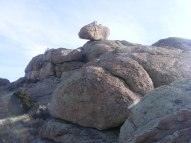 A boulder perched atop a mass