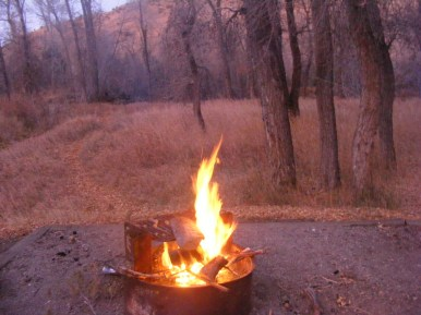 Campfire in the alpenglow, Encampment River Campground