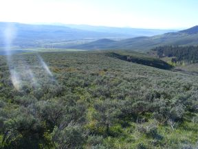 Above Cunningham Gulch, looking down into the valley of Ohio Creek; Tomichi Dome barely visible through the haze