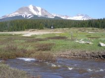 Looking across Snow Spur Creek and Colorado 145 towards Sheep Mountain and