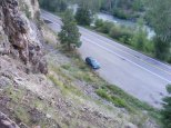 The car awaits at the Independence Trailhead on Colorado 149, Lake Fork of the Gunnison River across the highway