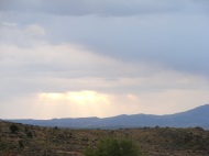 Sun shining through a hole in the clouds, from a pullout on Ashley National Forest Road 146