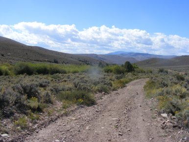 Looking south on BLM Road 3107 and Cabin Creek; Sawtooth Mountain on the horizon