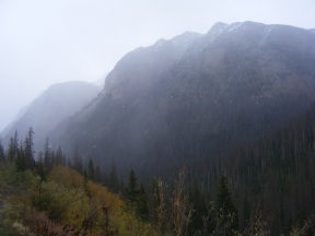 Cliffs and eminences rising above Cottonwood Creek on a rainy day in the San Juan Mountains of Colorado