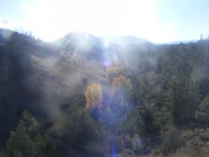 Sun shining down on the unnamed gully where BLM Road 3018 goes