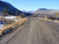 Looking north on Gunnison County Road 4; Anthracite Mesa to the right; Poverty Gulch in the distance under Augusta Mountain, Mineral Point and Purple Mountain