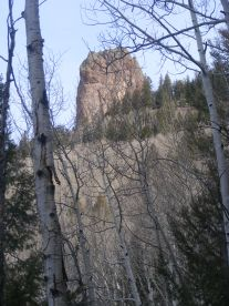 Tower of rock above the forest, on the slope above West Elk Creek