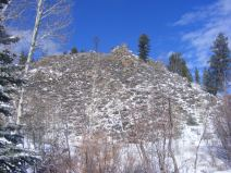 At the confluence with East Willow Creek, the snag on the bare hillside