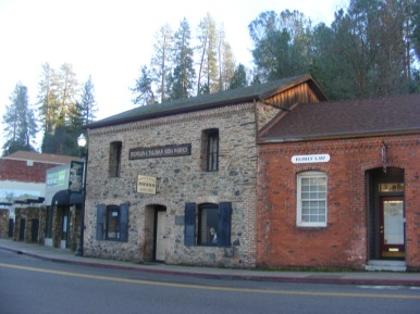Stone and brick buildings in Placerville, California; the stone edifice is now a museum