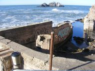 Surf slapping up against the ruins of the Sutro Baths