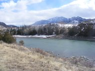 Looking upstream on the Yellowstone River fromthe Devil's Slide Overlook; Sepulcher Mountain beyond