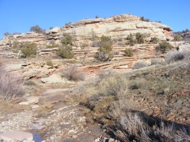 Sandstone strata abuts McDonald Creek near Castle Rocks