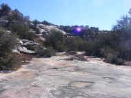 Above McDonald Creek, on the flat surface of a sandstone layer