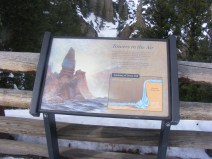 At the overlook for Tower Falls, interpretive signage in Yellowstone National Park